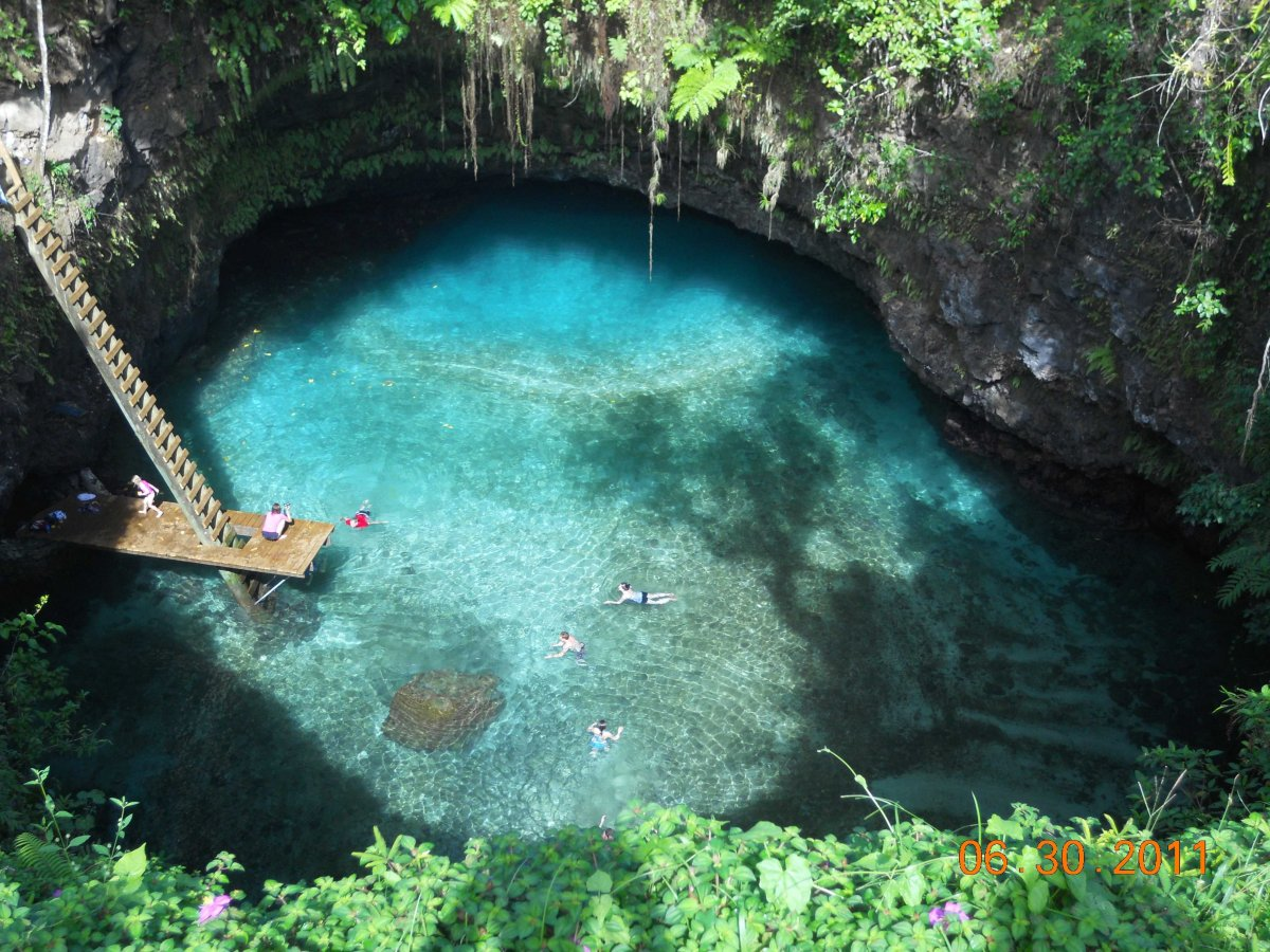 swim-in-the-to-sua-ocean-trench-a-30-meter-deep-natural-seawater-pool-surrounded-by-stunning-gardens-in-the-village-of-lotofaga-in-samoa
