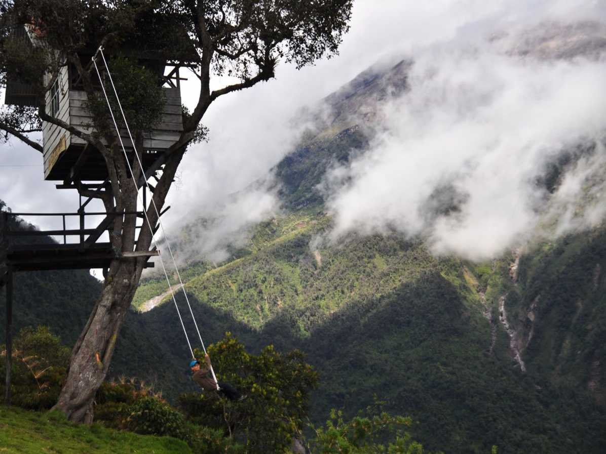 swing-on-the-swing-at-the-end-of-the-world-at-the-casa-de-arbol-in-ecuador-and-catch-stunning-views-of-the-tungurahua-volcano