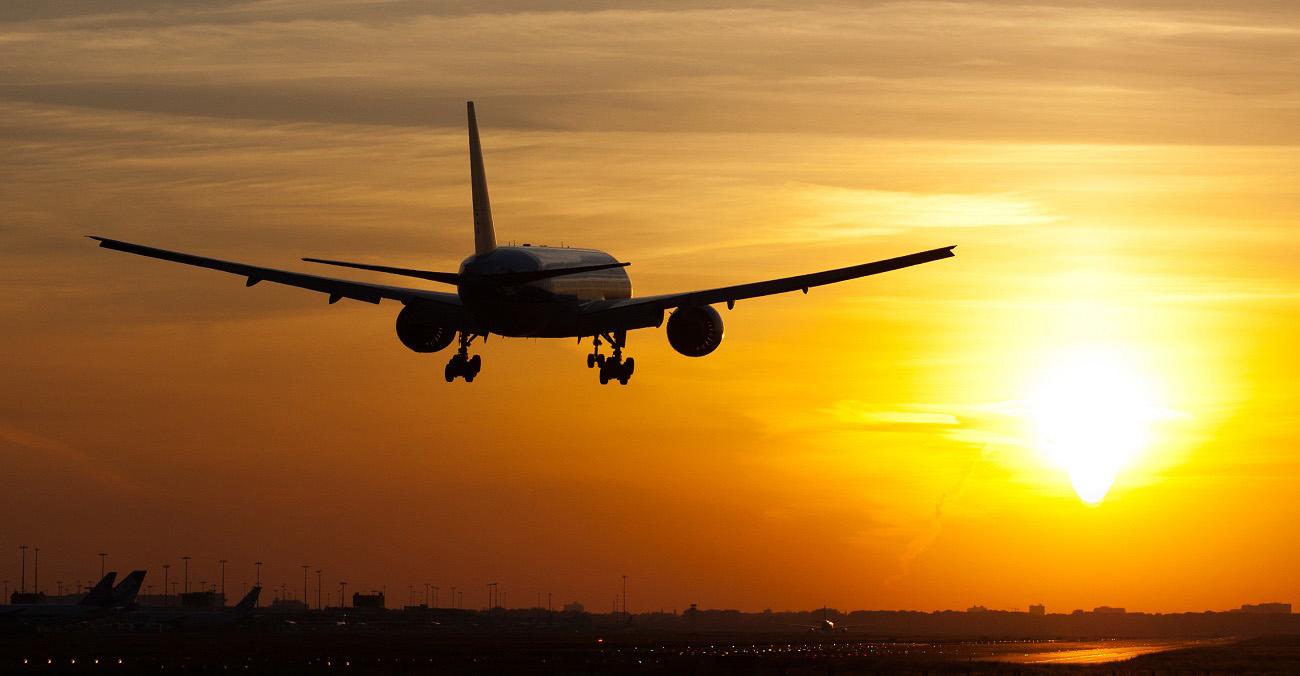 Plane landing in sunrise